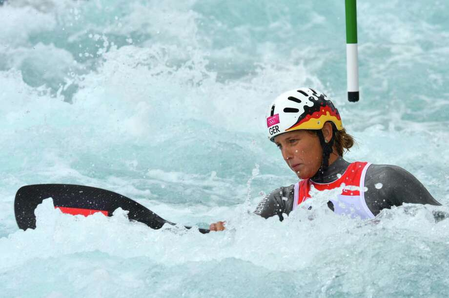 "Germany's Jasmin Schornberg competes in the Kayak Single Women's Slalom Semi-final at the "" Lee Valley White Water Centre"", on August 2, 2012 in London, on day 6 of the London 2012 Olympic Games.  AFP PHOTO / YURI CORTEZYURI CORTEZ/AFP/GettyImages Photo: YURI CORTEZ, AFP/Getty Images / AFP"