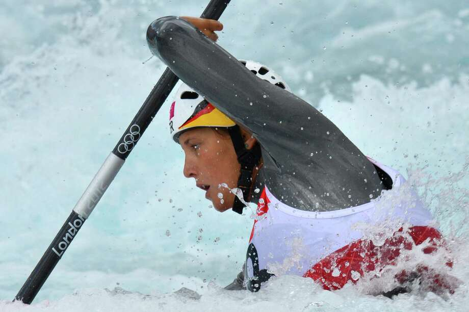 "Germany's Jasmin Schornberg competes in the Kayak Single Women's Slalom Semi-final at the "" Lee Valley White Water Centre"", on August 2, 2012 in London, on day 6 of the London 2012 Olympic Games.  AFP PHOTO / YURI CORTEZ/AFP/GettyImages Photo: AFP/Getty Images / AFP"