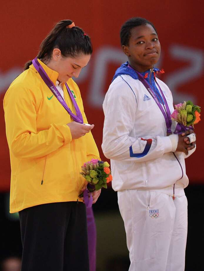 Brazil's Mayra Aguiar (L) and France's Audrey Tcheumeo gesture on the podium of the women's -78kg judo contest of the London 2012 Olympic Games on August 2, 2012 at the ExCel arena in London.  AFP PHOTO / JOHANNES EISELEJOHANNES EISELE/AFP/GettyImages Photo: JOHANNES EISELE, AFP/Getty Images / AFP