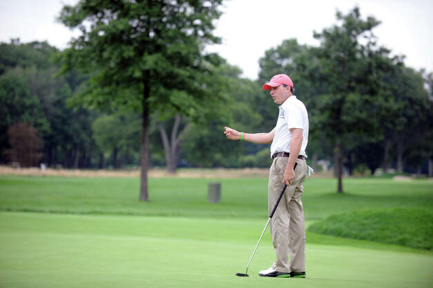 Jason Caron lines encourages a putt as he works toward winning the 78th Connecticut Open Championship at Wee Burn Country Club in Darien, Conn., August 1, 2012. Photo: Keelin Daly / Stamford Advocate