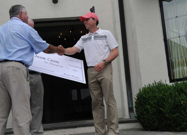 Jason Caron collects a $10,000 check as he wins the 78th Connecticut Open Championship at Wee Burn Country Club in Darien, Conn., August 1, 2012. Photo: Keelin Daly / Stamford Advocate