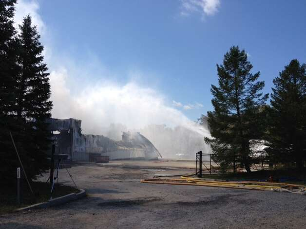 Firefighters continued to battle a fire Thursday afternoon at TCI of New York on Falls Industrial Road in Ghent. (State Office of Homeland Security)
