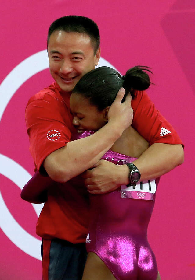LONDON, ENGLAND - AUGUST 02:  Gabrielle Douglas of the United States hugs her coach Liang Chow after the floor exercise in the Artistic Gymnastics Women's Individual All-Around final on Day 6 of the London 2012 Olympic Games at North Greenwich Arena on August 2, 2012 in London, England. Photo: Ronald Martinez, Getty / 2012 Getty Images