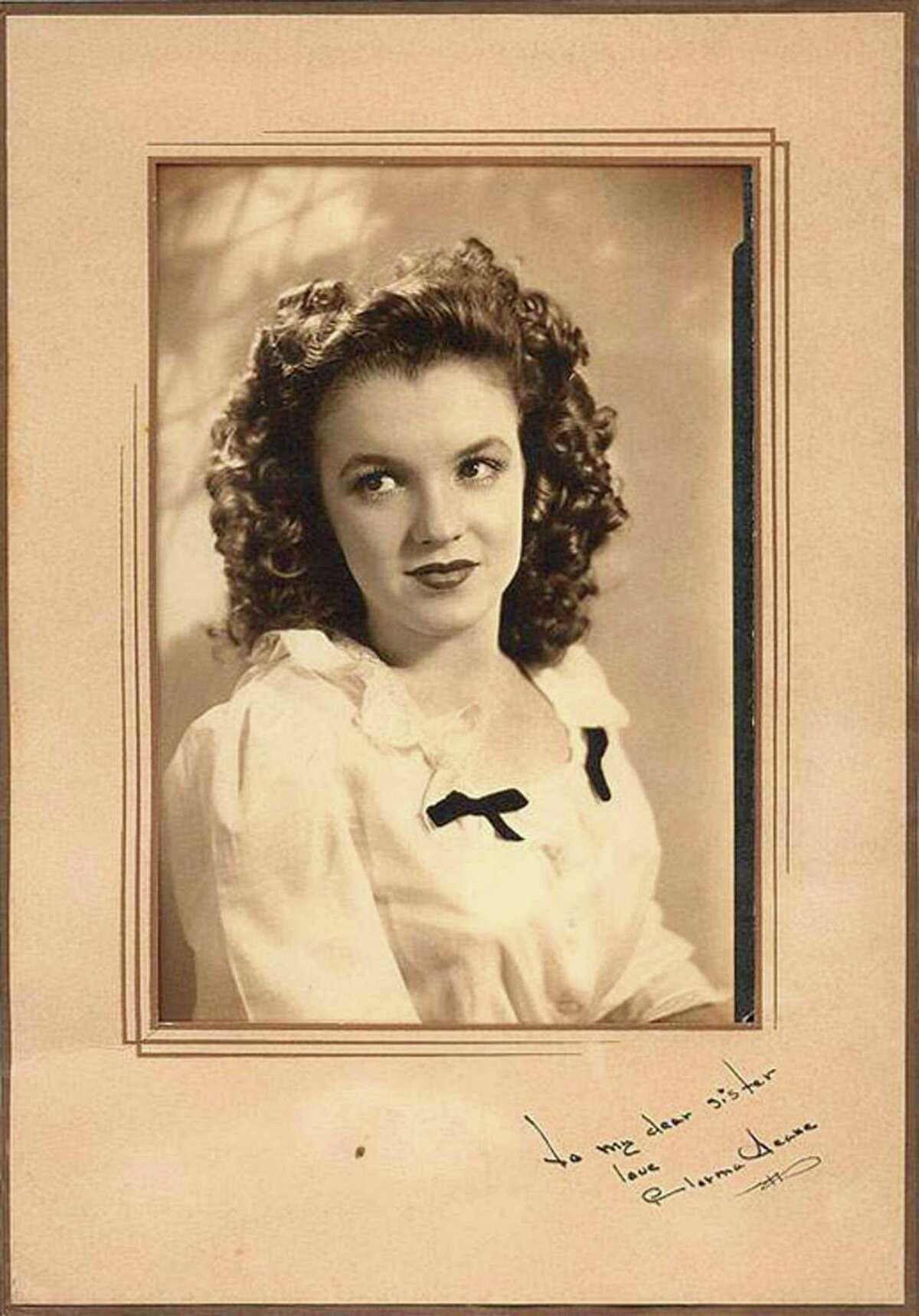 The vintage portrait of Norma Jean Dougherty, also known as actress Marilyn Monroe, with a rare autograph and dedication