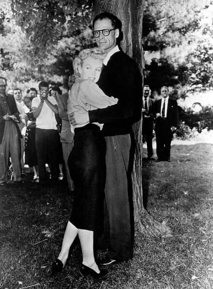 Actress Marilyn Monroe and playwright Arthur Miller embrace on the lawn of Miller's home in Roxbury,