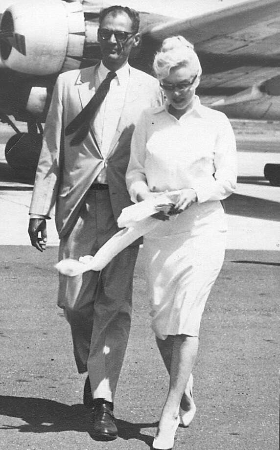 Marilyn Monroe arrives at the  Reno-Tahoe International Airport in Reno, Nev., with her husband, playwright Arthur Miller, in this July, 1960 file photo. Photo: AP / RENO GAZETTE JOURNAL