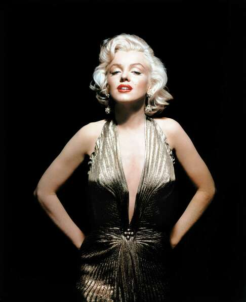 In this undated publicity photo courtesy Running Press, Marilyn Monroe is shown wearing a knife-plea