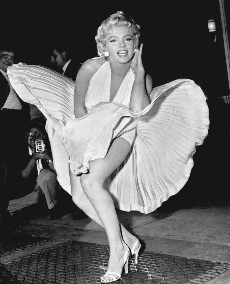 "In this Sept. 9, 1954 file photo, Marilyn Monroe poses over the updraft of New York subway grating while in character for the filming of ""The Seven Year Itch"" in Manhattan. The former Norma Jean Baker modeled and starred in 28 movies grossing $200 million. Sensual and seductive, but with an air of innocence, Monroe became one of the world's most adored sex symbols. Photo: Matty Zimmerman, Associated Press / AP"
