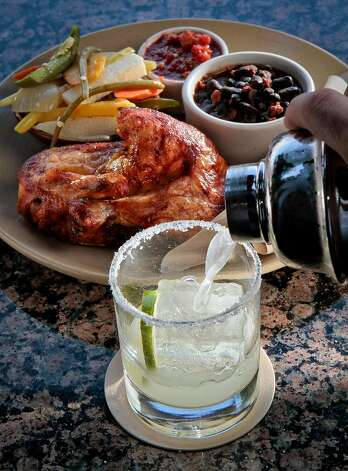 The wood-roasted chicken with a margarita at Copita Tequileria y Comida. Photo: John Storey, Special To The Chronicle