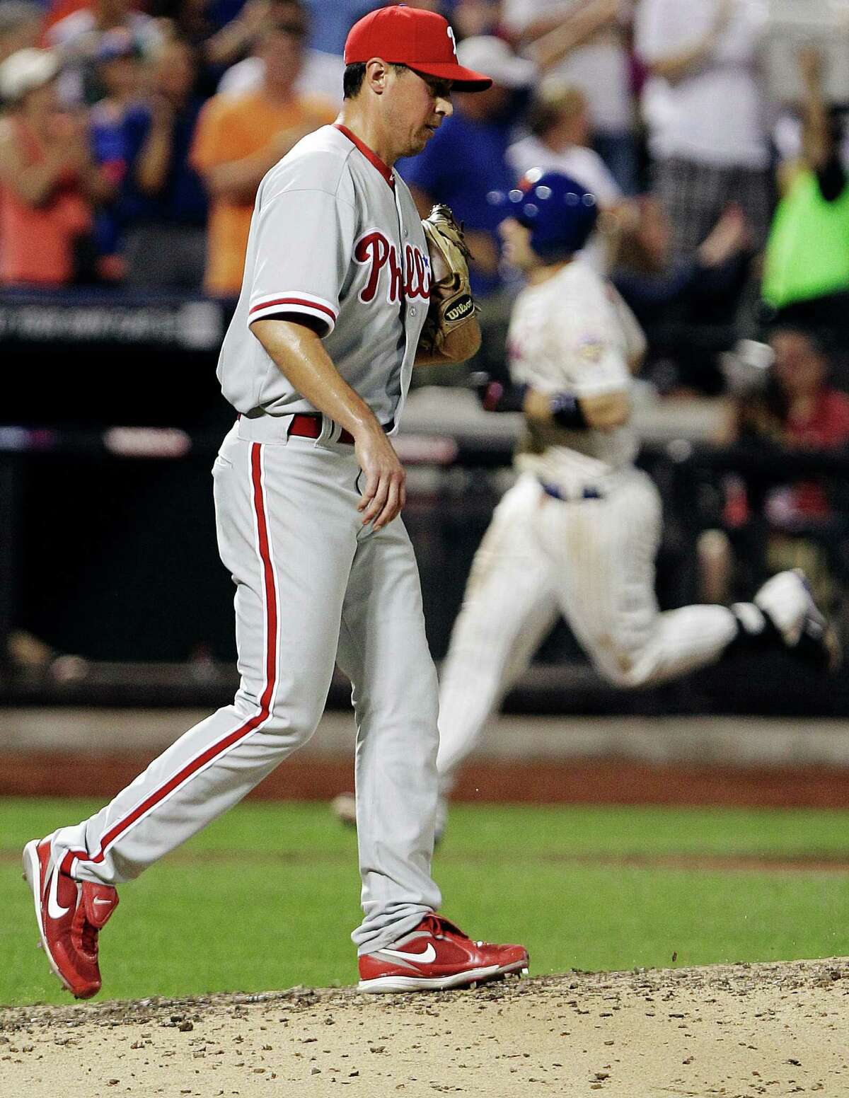 Philadelphia Phillies relief pitcher Brian Sanches reacts as New York Mets' David Wright head to home plate after hitting a three-run home run during the sixth inning of a baseball game, Tuesday, July 3, 2012, in New York. (AP Photo/Frank Franklin II)