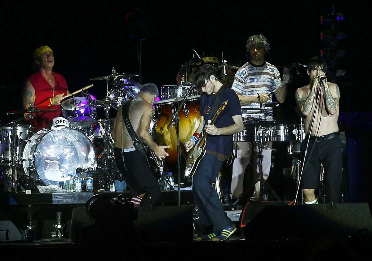 The Red Hot Chili Peppers perform during the Rock in Rio music festival in Arganda del Rey, on the outskirts of Madrid, Spain, Sunday, July 8, 2012. (AP Photo/Andres Kudacki)