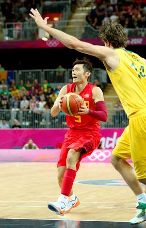 Wei Liu #5 of China drives against Matt Nielsen #14 of Australia in the second half during the Men's Basketball Preliminary Round match on Day 6 of the London 2012 Olympic Games at Basketball Arena on August 2, 2012 in London, England. (Christian Petersen / Getty Images)