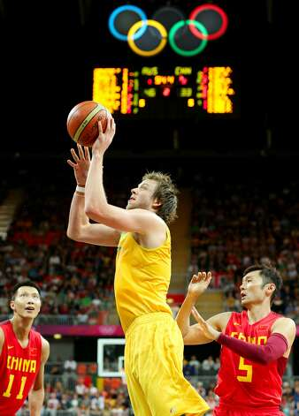 Joe Ingles #7 of Australia shoots against Jianlian Yi #11 of China and Wei Liu #5 of China in the first half during the Men's Basketball Preliminary Round match on Day 6 of the London 2012 Olympic Games at Basketball Arena on August 2, 2012 in London, England. (Christian Petersen / Getty Images)