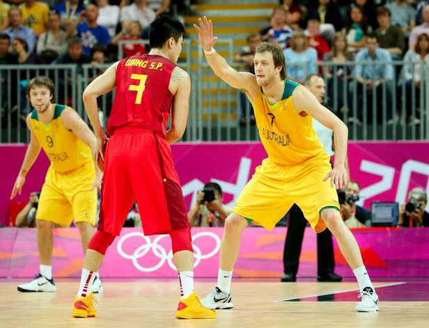 Shipeng Wang #7 of China looks to pass against Joe Ingles #7 of Australia in the first half during the Men's Basketball Preliminary Round match on Day 6 of the London 2012 Olympic Games at Basketball Arena on August 2, 2012 in London, England. (Christian Petersen / Getty Images)