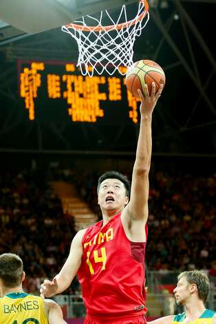 Zhizhi Wang #14 of China shoots against Aron Baynes #12 of Australia in the second half during the Men's Basketball Preliminary Round match on Day 6 of the London 2012 Olympic Games at Basketball Arena on August 2, 2012 in London, England. (Christian Petersen / Getty Images)