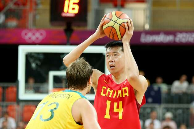 Zhizhi Wang #14 of China looks to pass against David Andersen #13 of Australia in the second half during the Men's Basketball Preliminary Round match on Day 6 of the London 2012 Olympic Games at Basketball Arena on August 2, 2012 in London, England. (Christian Petersen / Getty Images)