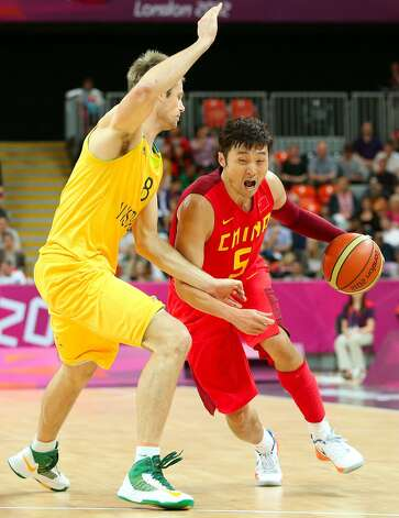 Wei Liu #5 of China drives against Brad Newley #8 of Australia in the second half during the Men's Basketball Preliminary Round match on Day 6 of the London 2012 Olympic Games at Basketball Arena on August 2, 2012 in London, England. (Christian Petersen / Getty Images)