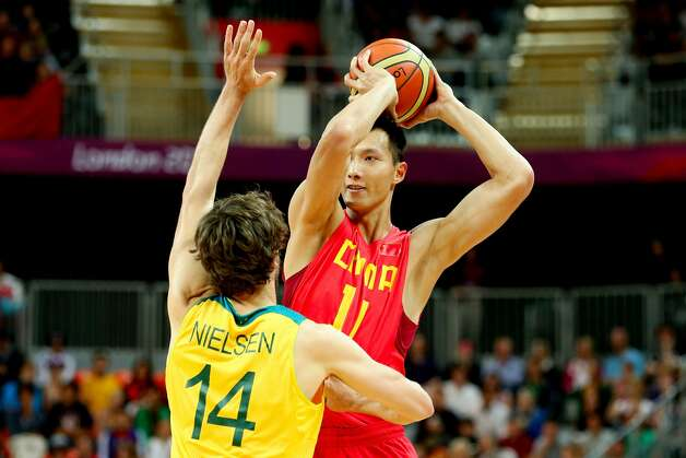 Jianlian Yi #11 of China looks to pass against Matt Nielsen #14 of Australia in the second half during the Men's Basketball Preliminary Round match on Day 6 of the London 2012 Olympic Games at Basketball Arena on August 2, 2012 in London, England. (Christian Petersen / Getty Images)
