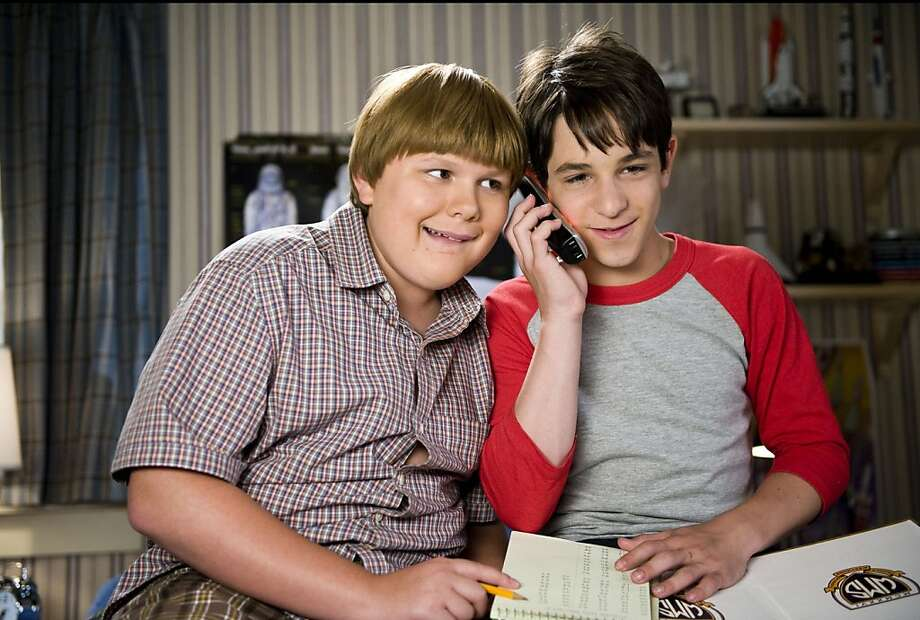 """This undated film image released by 20th Century Fox shows, Zachary Gordon, right, and Robert Capron in a scene from """"Diary of a Wimpy Kid: Dog Days."""" (AP Photo/20th Century Fox, Diyah Pera) Photo: Diyah Pera, Associated Press"""