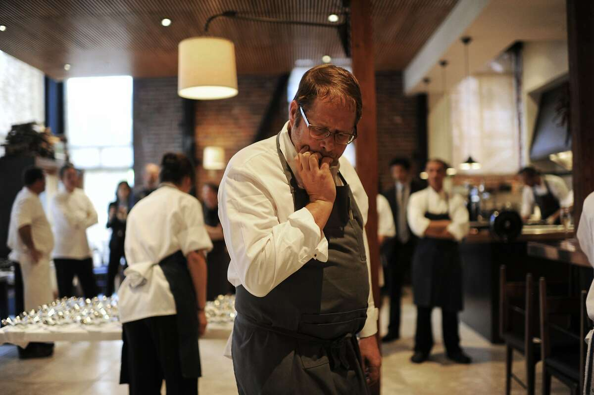 Chef David Kinch, center, checks his course before it gets served in the kitchen of Quince on Sunday, July 29, 2012 in San Francisco, Calif.