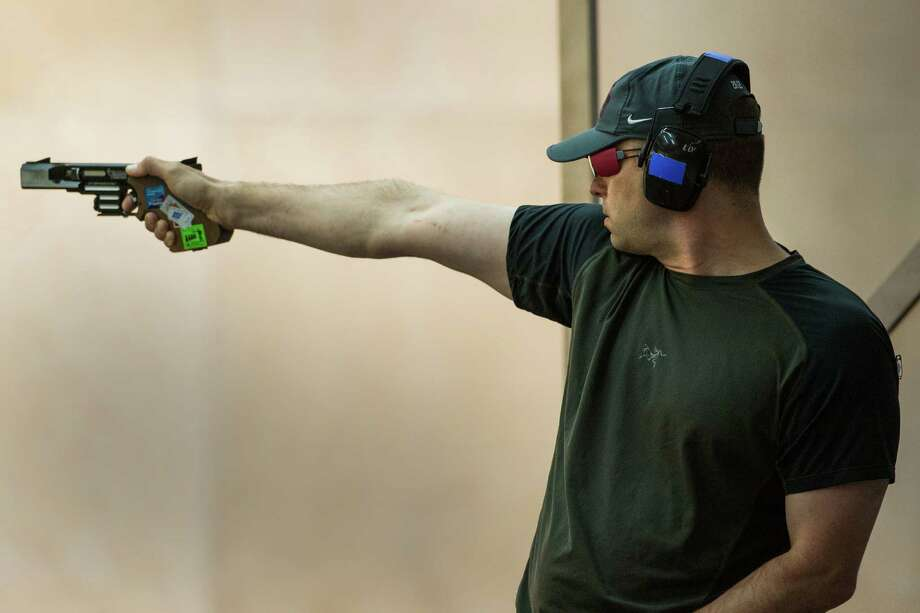 Keith Sanderson competes in qualifying for the men's rapid fire pistol shooting event at the 2012 Summer Olympics on Thursday, Aug. 2, 2012, in London. Photo: Jay Hu, For The Houston Chronicle / © 2012  Houston Chronicle