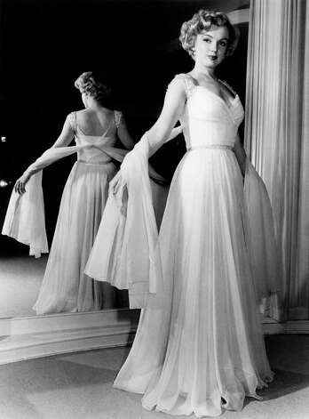 For a 1951 magazine layout, Marilyn Monroe models a pale blue chiffon goddess gown by Don Loper who catered to Hollywood royalty. / HC