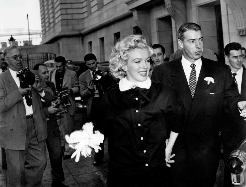 Mr. and Mrs. Joe DiMaggio emerge from their civil wedding ceremony in San Francisco on Jan. 14, 1954
