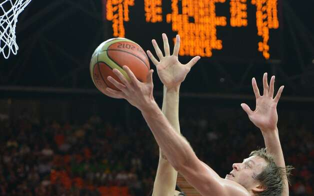 Australian forward Joe Ingles jumps to score during the men's preliminary round Groupe B basketball match Australia vs China of the London 2012 Olympic Games  on August 2, 2012 at the basketball arena in London. Australia won 49-23. (MARK RALSTON / AFP/Getty Images)