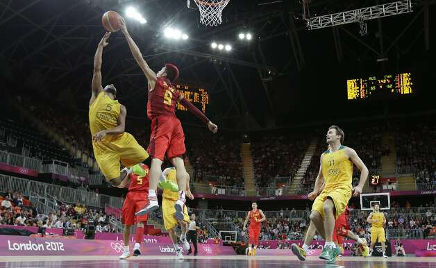 Australia's Patrick Mills (5) is blocked by China's Sun Yue (9) during a preliminary men's basketball game at the 2012 Summer Olympics, Thursday, Aug. 2, 2012, in London. (Eric Gay / Associated Press)