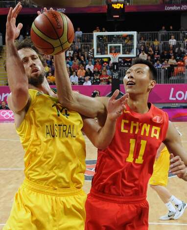 China's Yi Jianlian (11) vies for the ball with Australia's Matt Nielsen (14) during a men's basketball game at the 2012 Summer Olympics Thursday, Aug. 2, 2012, in London. (Mark Ralston / Associated Press)