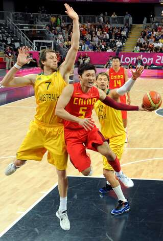 China's Liu Wei (5) drives against Australia's Joe Ingles (7) during a men's basketball game at the 2012 Summer Olympics Thursday, Aug. 2, 2012, in London. (Mark Ralston / Associated Press)