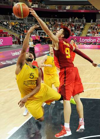 China's Sun Yue (9) and Australia's Patrick Mills (5) vie for possession during a men's basketball game at the 2012 Summer Olympics Thursday, Aug. 2, 2012, in London. (Mark Ralston / Associated Press)