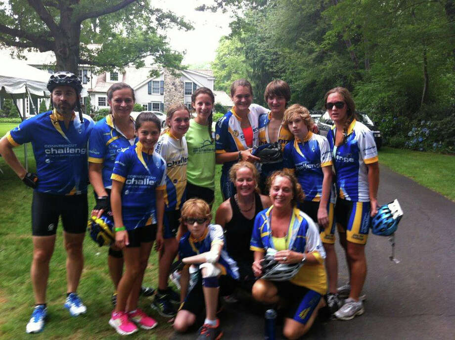 Team Darien-New Canaan takes a quick break at one of the rest stops of the 25-mile course at the eighth 2012 CT Bike Ride Challenge on Saturday in Westport. Photo: Contributed Photo / CT
