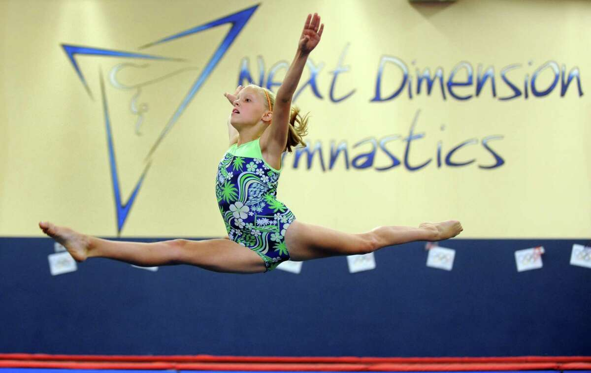 Eleven-year-old gymnast Ashley Anderson, of Monroe, trains at Next Dimension Gymnastics in Trumbull Thursday, August 2, 2012. Anderson does not appreciate all of the Olympic spoilers.