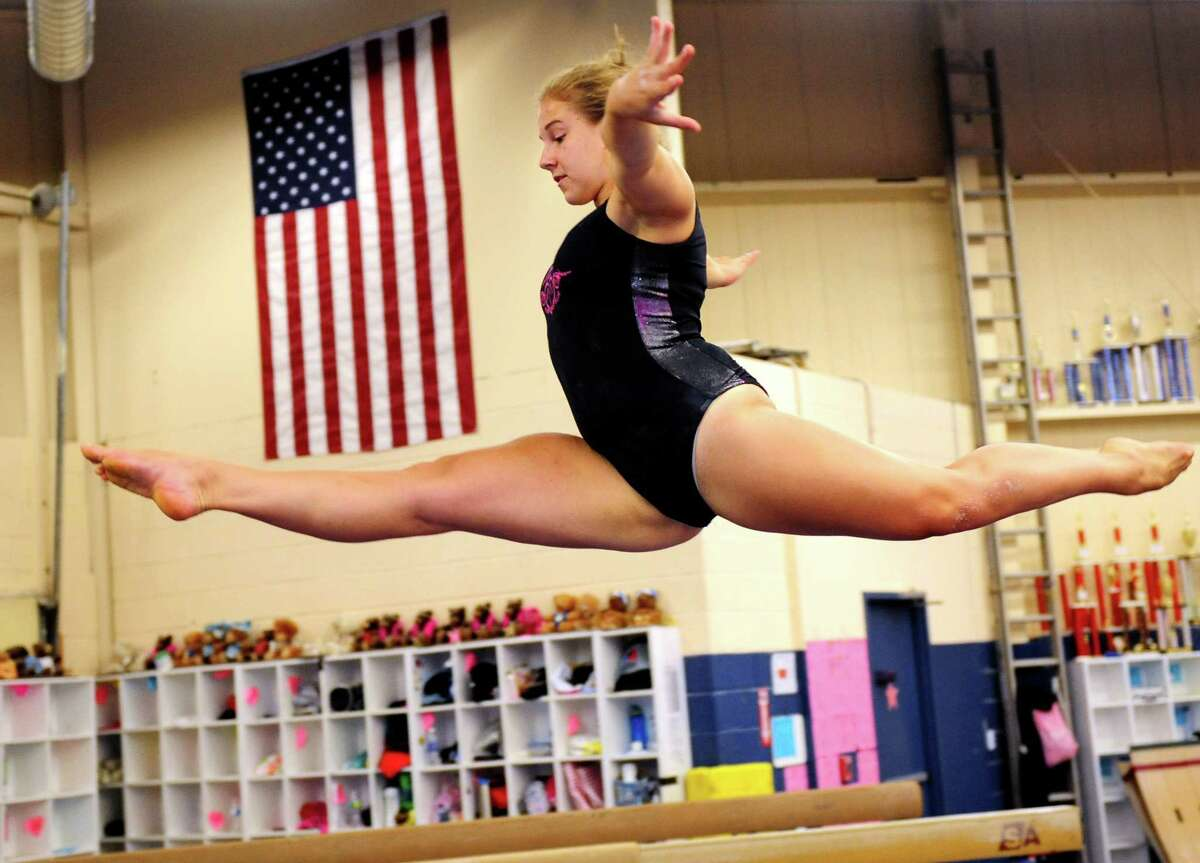 Jessica Konkol, 18, of Trumbull, practices her balance beam routine at Next Dimension Gymnastics in Trumbull Thursday, August 2, 2012.