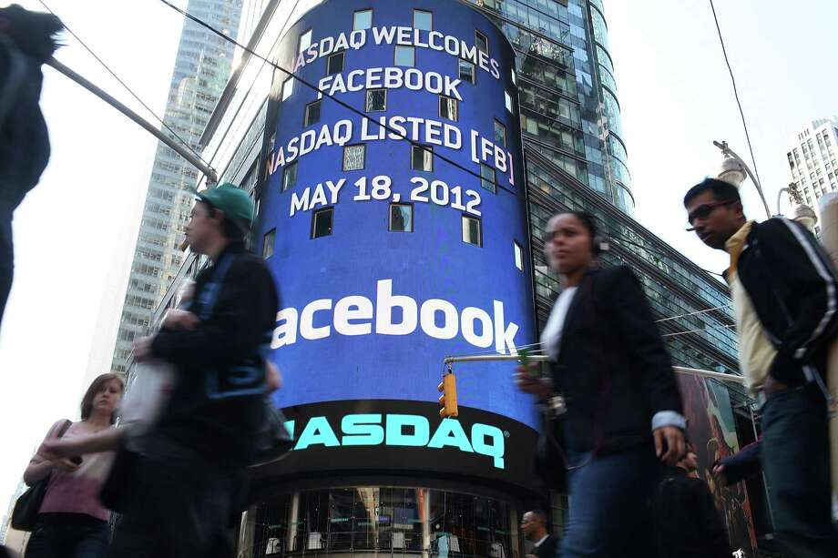 FILE - JULY 26: Facebook has announced it's first earnings as a public company on July 26, 2012 in New York City. Revenue beat Wall Street expectations although shares fell 2.4 percent to $26.19, 29 percent down from it's IPO. Advertising revenue went up 28 percent to %992 million with costs and expensese rising to $1.93 million. . . NEW YORK, NY - MAY 18:  The Nasdaq board in Times Square advertises Facebook which is set to debut on the Nasdaq Stock Market today on May 18, 2012 in New York, United States. The social network site is set to begin trading at roughly 11:00 a.m. ET and on Thursday priced 421 million shares at $38 each. Facebook, a Menlo Park, California based company, will have a valuation exceeding $100 billion. Photo: Spencer Platt, Getty Images / 2012 Getty Images