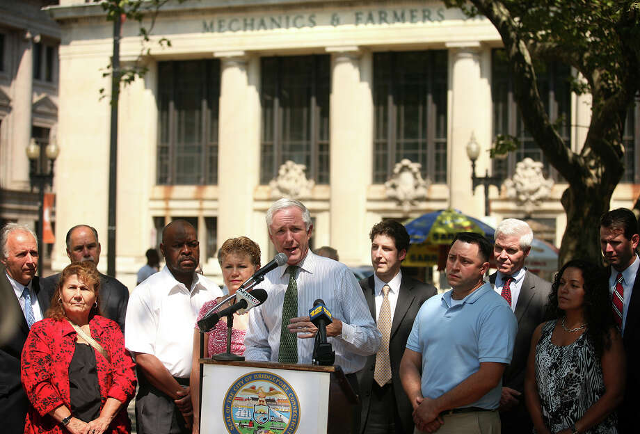 Bridgeport Mayor Bill Finch announces that three city affordable housing development projects, including the Mechanics & Farmers bank building, received state grant money, on McLevy Green in downtown Bridgeport on Thursday, August 2, 2012. Photo: Brian A. Pounds / Connecticut Post