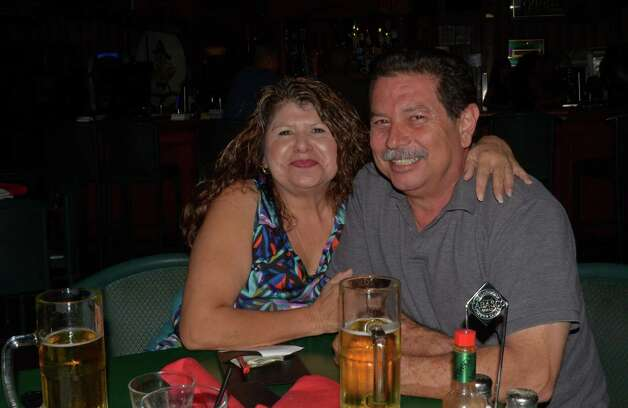 Terry Uriegas (cq) and her brother Joe Angel Loza start their Friday night with live music and drinks at Firehouse Pub and Grill on July 26, 2012. Robin Johnson