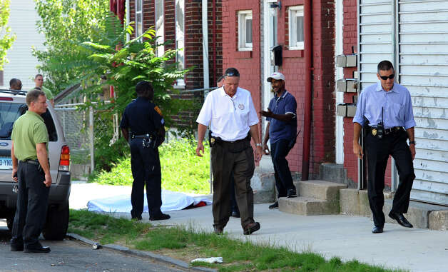 Bridgeport police investigate the homicide of Gary Gullap, 17, on Hallett and Ogden Streets in Bridgeport, Conn. on Thursday August 2, 2012. Photo: Christian Abraham / Connecticut Post