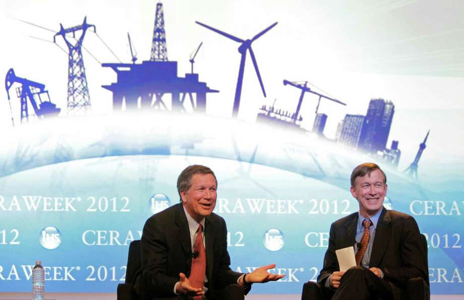Ohio Gov. John Kasich, left, and Colorado Gov. John Hickenlooper were on an energy panel in March in Houston. Kasich, who wants to hike taxes on energy producers, claims that a single firm could reap $1 trillion in Ohio gas and oil. Photo: Melissa Phillip / © 2012 Houston Chronicle