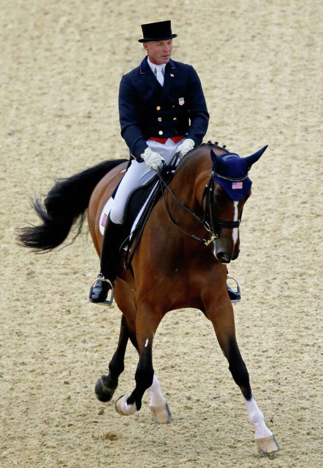 Jan Ebeling, of the United States, rides Rafalca, in the equestrian dressage competition at the 2012 Summer Olympics, Thursday, Aug. 2, 2012, in London. Rafalca is co-owned by Ann Romney, the wife of U.S. Republican presidential candidate Mitt Romney. (AP Photo/David Goldman) Photo: David Goldman / AP