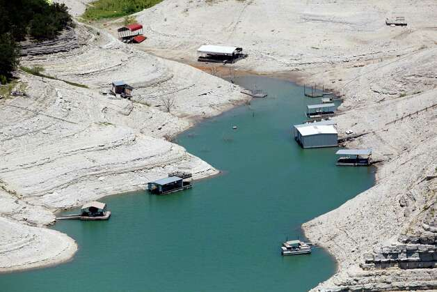 Medina Lake now is just 16 percent full, according to the Texas Water Development Board's website. It's almost 60 feet low and is losing a few more inches, or a little more than 0.1 percent of its water, every day. Photo: William Luther, San Antonio Express-News / © 2012 San Antonio Express-News