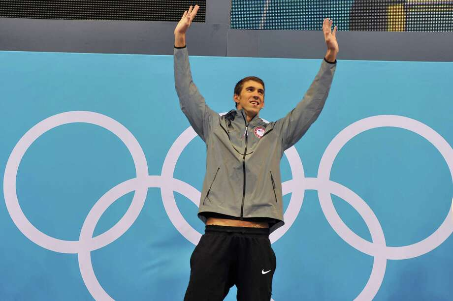 Michael Phelps captured his 16th gold medal with his third straight Olympic win in the 200-meter individual medley. Photo: CHRISTOPHE SIMON, AFP/Getty Images / AFP