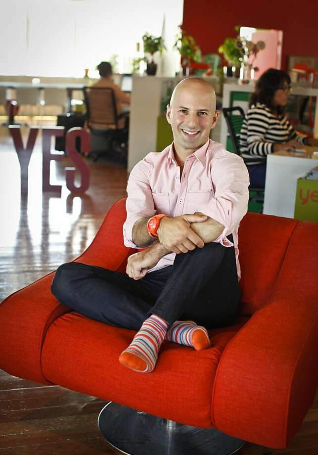 Australian-born Ido Leffler, above, in his company's SoMa office in S.F., decided to sport a bit of orange every day after he clinched a deal while wearing an orange tie. Photo: Russell Yip, The Chronicle