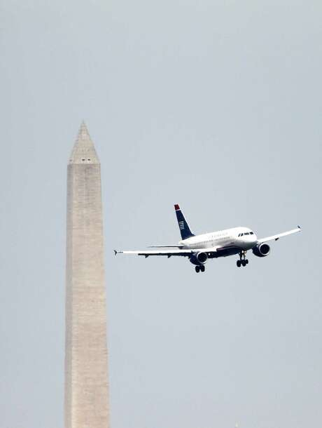 Airliners on their final approaches to Ronald Reagan Washington National are a common sight in the National Mall area. Photo: Haraz N. Ghanbari, STF / AP