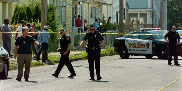 Bridgeport police look for bullet casings as they investigate the homicide of Gary Gullap, 17, on Ogden and Hallett Streets in Bridgeport, Conn. on Thursday August 2, 2012. Photo: Christian Abraham / Connecticut Post