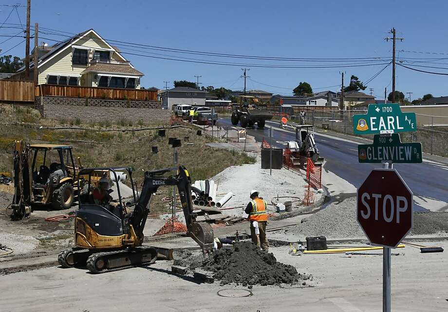 A PG&E crew replaces a two-inch gas line in San Bruno, Calif. on Thursday, Aug. 2, 2012 after it was punctured by an independent contractor digging at Earl Avenue and Glenview Drive, the exact location of the gas line explosion nearly two years ago. Photo: Paul Chinn, The Chronicle