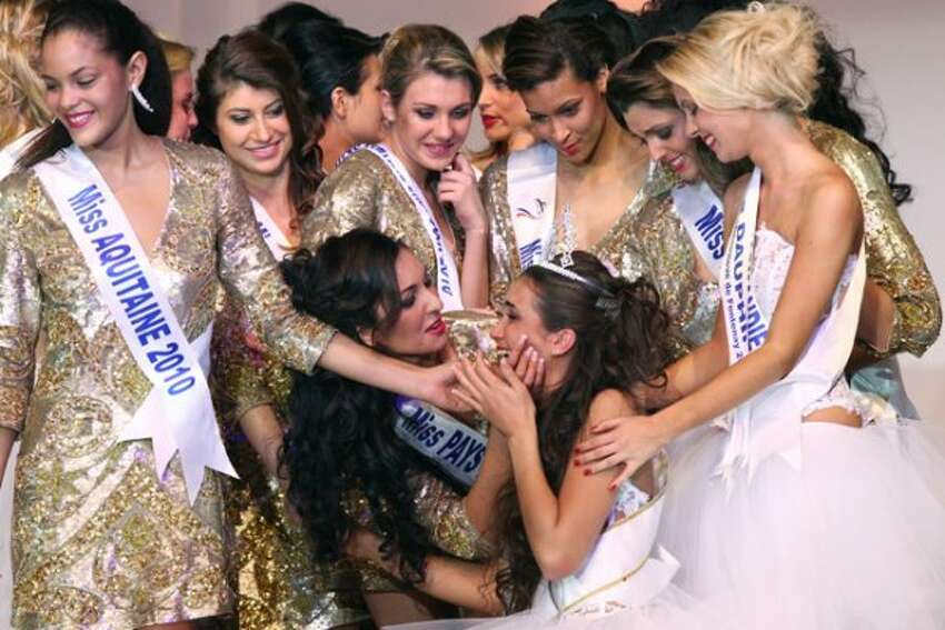 Miss Provence Barbara Morel (R-bottom), reacts after being crowned Miss Nationale 2011 beauty contest of the