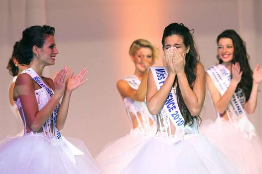 Miss Provence Barbara Morel (2R), reacts after being crowned Miss Nationale 2011 beauty contest of the