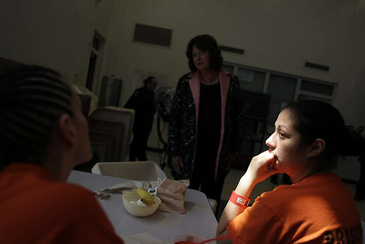 Elizabeth Marie Vasquez (right) listens as another inmate talks with San Mateo County Supervisor Adrienne Tissier (center) in the C dorm at the San Mateo County Women's Correctional Facility on Thursday, May 24, 2012 in Redwood City, Calif.